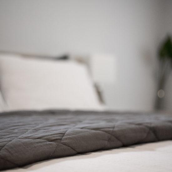 Cotton bedding and memory foam mattress.