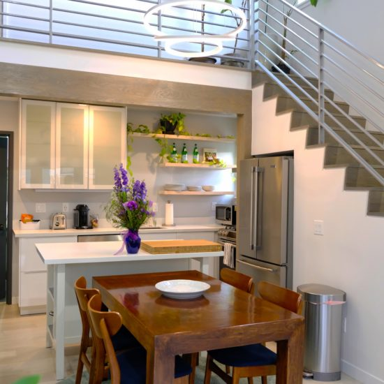 """alt=""""picture of the dining room, kitchen and loft area of the luxury vacation rental in Portland Oregon"""""""