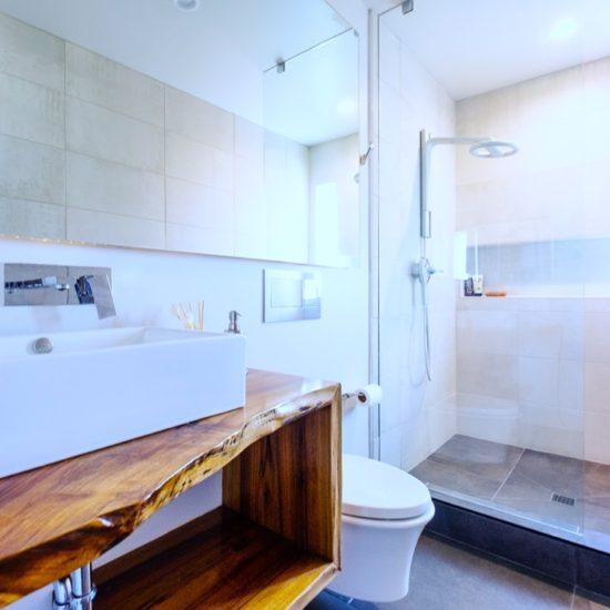 Oversize spa shower • Italian tile • Heated floors • Speakers