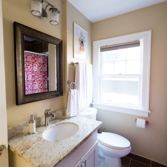 bright bathroom and full soaker tub.