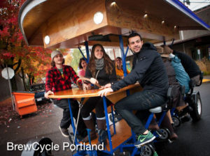 "alt=""picture of people having fun in Portland on a BrewCycle"""