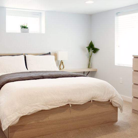 "alt=""picture of the bright comfortable master bedroom at the Chez Sealy PDX vacation bed and breakfast in Portland"""